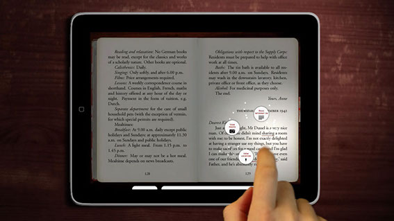 Here a finger is tapping on a highlighted word in the Diary.  The page darkens as the background content options swirl around the reader's finge